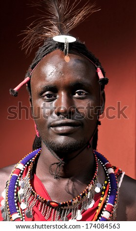 MAASAI MARA, KENYA - AUGUST 10: Maasai man in the village on August 10, 2010. The Maasai are the most famous tribe in Africa. They are nomadic and live in small villages. - stock photo