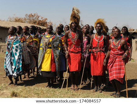 MAASAI MARA, KENYA - AUGUST 12: Maasai men in the village on August 12, 2010. The Maasai are the most famous tribe in Africa. They are nomadic and live in small villages. - stock photo