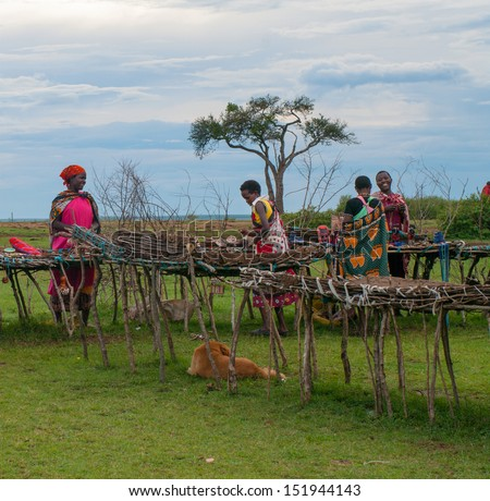 MAASAI MARA, KENYA-DECEMBER 27: Unidentified women sells traditional souvenirs 27 December, 2012 at Maasai Mara, Kenya. The Maasai are the most famous tribe in Africa.  - stock photo