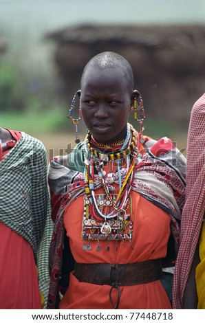 MAASAI MARA, KENYA - FEBRUARY 4: Maasai lady in the village, 4 February , 2004 at Masaai Mara, Kenya. The Maasai are the most famous tribe in Africa. They are nomadic and live in small villages. - stock photo