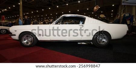 MAASTRICHT, NETHERLANDS - JANUARY 09, 2015: A pony car Ford Mustang GT Fastback, 1965. International Exhibition InterClassics & Topmobiel 2015 - stock photo