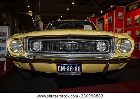 MAASTRICHT, NETHERLANDS - JANUARY 09, 2015: A pony car Ford Mustang GT Fastback, 1968. International Exhibition InterClassics & Topmobiel 2015 - stock photo