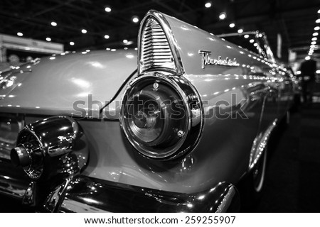 MAASTRICHT, NETHERLANDS - JANUARY 09, 2015: A stoplight of a personal luxury car Ford Thunderbird (first generation), 1955. Black and white. International Exhibition InterClassics & Topmobiel 2015 - stock photo