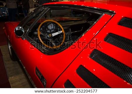 MAASTRICHT, NETHERLANDS - JANUARY 08, 2015: Cab of a sports car Alfa Romeo Montreal. International Exhibition InterClassics & Topmobiel 2015 - stock photo