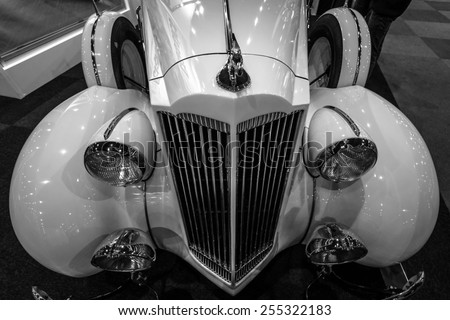 MAASTRICHT, NETHERLANDS - JANUARY 08, 2015: Fragment of a Packard 120 Convertible Sedan with Dietrich Body, 1937. Black and white. International Exhibition InterClassics & Topmobiel 2015 - stock photo