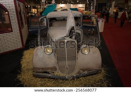 MAASTRICHT, NETHERLANDS - JANUARY 09, 2015: Rusty body of a compact car Renault Monaquatre, 1934. International Exhibition InterClassics & Topmobiel 2015 - stock photo