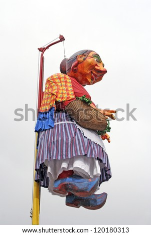 MAASTRICHT, THE NETHERLANDS - FEBRUARY 26: Mooswief - carnival mascot in the Carnival parade on February 26, 2006 in Maastricht, Netherlands. This parade is organized yearly, about 100,000 visitors. - stock photo