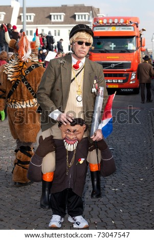 MAASTRICHT, THE NETHERLANDS - MARCH 6: Unidentified man in the Carnival parade on March 6, 2011 in Maastricht, The Netherlands. This parade is organized every year and attracks about 100,000 visitors. - stock photo