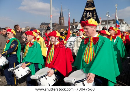 MAASTRICHT, THE NETHERLANDS - MARCH 6: Unidentified men of a brass band in the Carnival parade on March 6, 2011 in Maastricht, The Netherlands. This parade is organized every year with about 100,000 visitors. - stock photo
