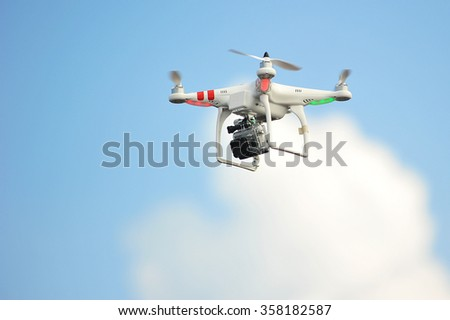 Mabul Sabah, Malaysia -Nov 3, 2013: DJI brand drone mounted with GoPro Camera seen flying in Mabul Semporna Sabah on Nov 3, 2013.Drone is a popular solution for ariel photography and videography. - stock photo