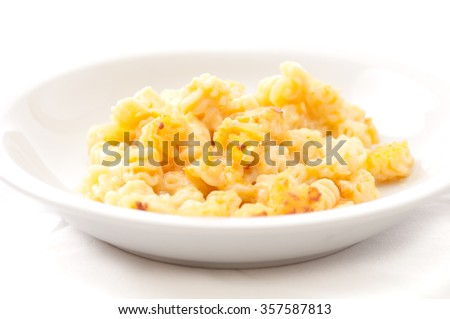 mac and cheese style radiatori pasta with gruyere cheese and cheddar in a bechamel sauce - stock photo