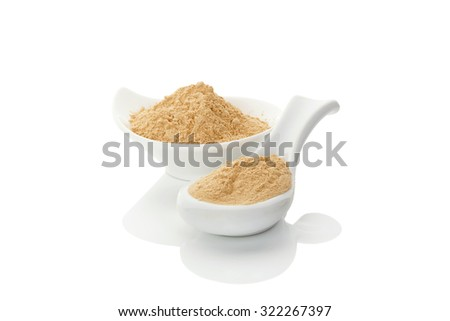 Maca powder on spoon and in a bowl isolated on white background. Natural alternative medicine. - stock photo