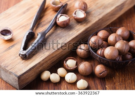 Macadamia nuts on a wooden table - stock photo