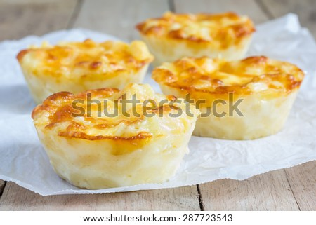 Macaroni and cheese baked as a little pies - stock photo