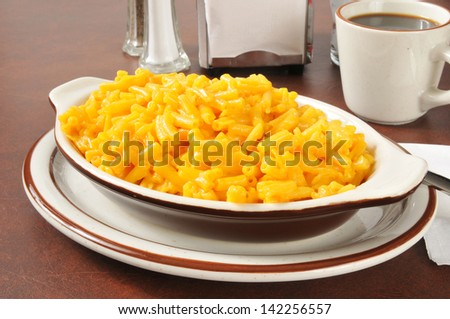 Macaroni and cheese in a casserole dish with coffee - stock photo