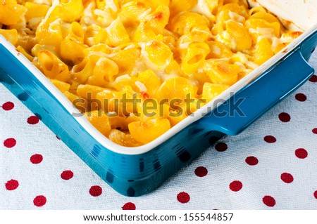 Macaroni and melted cheese in the blue bowl - stock photo