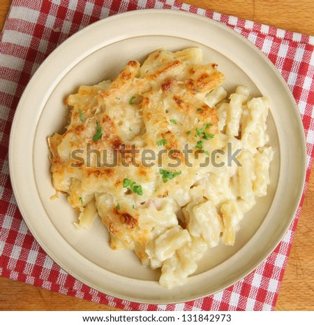 Macaroni cheese meal in beige bowl. - stock photo