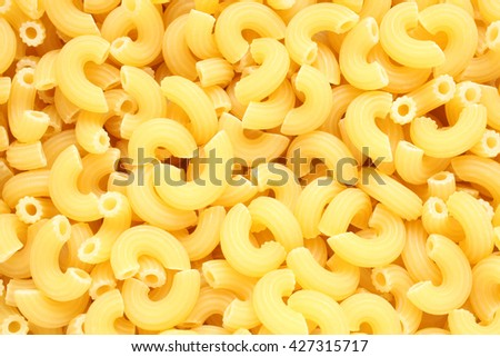 Macaroni pasta, for backgrounds or textures - stock photo