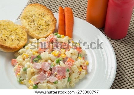 Macaroni salad with mayonnaise and vegetables. - stock photo