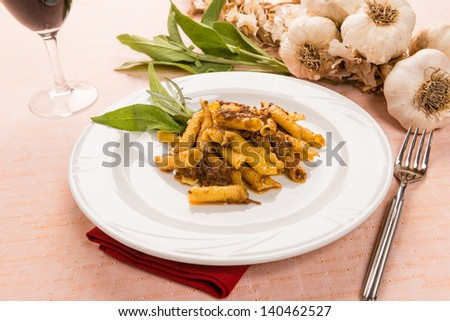 Macaroni with game sauce in white dish - stock photo