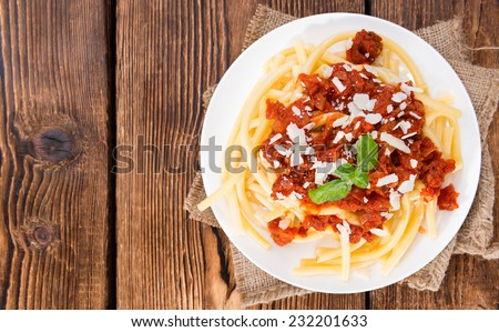 Macaroni with homemade Tomato Sauce (close-up shot) on an old wooden table - stock photo
