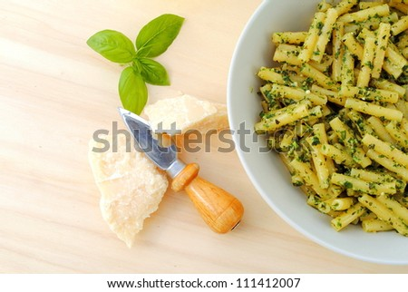 macaroni with typical italian sauce of crushed basil, cheese and oil - stock photo