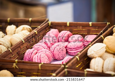 Macarons assortment in a wickered boxes. Horizontal shot with selective focus - stock photo