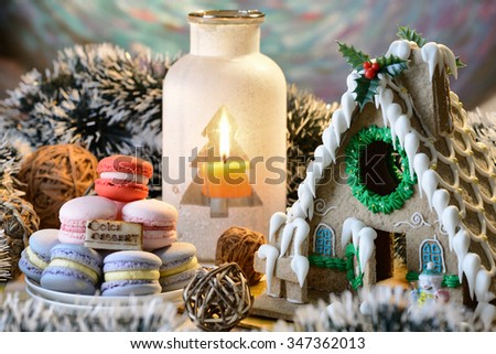 macaroon and ginger bread house for Christmas dessert - stock photo
