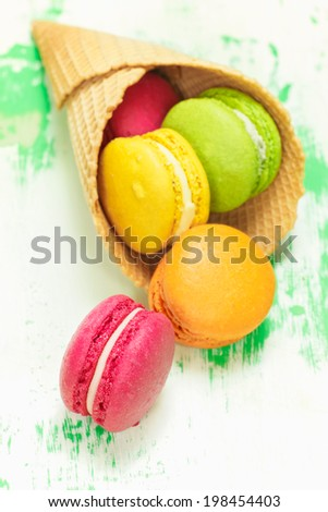 Macaroons. Colorful Macarons in ice cream cone - stock photo