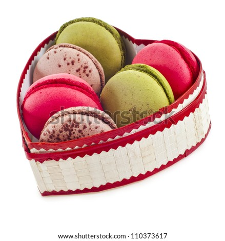 macaroons cookies on a heart box isolation on a white background - stock photo