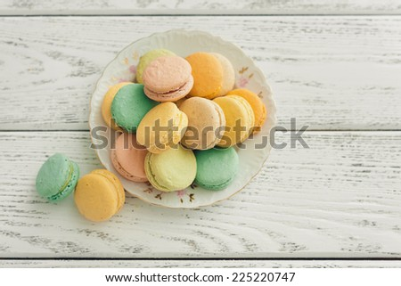 macaroons on wooden background - stock photo