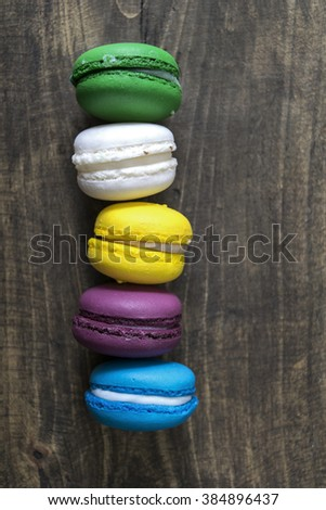 macaroons on wooden table, from above - stock photo