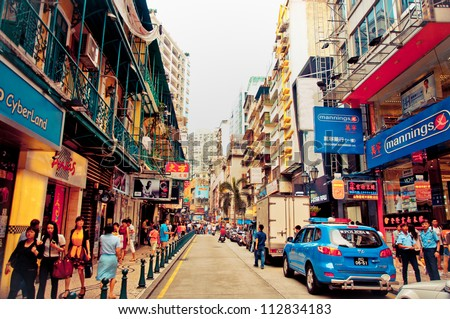 MACAU - AUGUST 1:view on downtown street August 1, 2012 in Macau, China. Macau features a strong tourism industry based on gambling and is visited by over 25 million people every year - stock photo