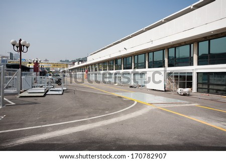 MACAU, CHINA - NOVEMBER 2, 2012: Construction of garage boxes for cars and preparation track for race Macau Grand Prix in stages Formula 3, FIA WTCC, motorcycle prize. Race takes place on the streets. - stock photo