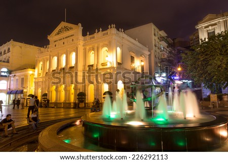 MACAU, CHINA - OCTOBER 15, 2014 -Night scene of Senado Square is located at the center of Macau which is the most famous touring spot. - stock photo