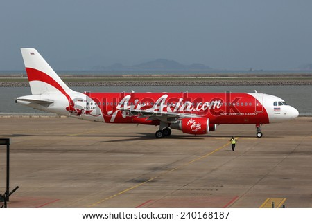MACAU, CHINA - SEPTEMBER 25: An Air Asia Airbus A320 preparing for take-off on September 25, 2013 in Macau. Air Asia is a low-cost airline from Malaysia. - stock photo