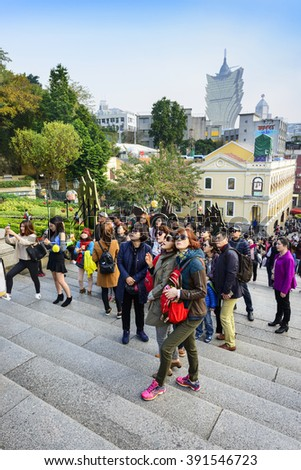 Macau - February 17, 2015: People are visiting Ruins of St. Paul's, one of Macau's best known landmarks. - stock photo