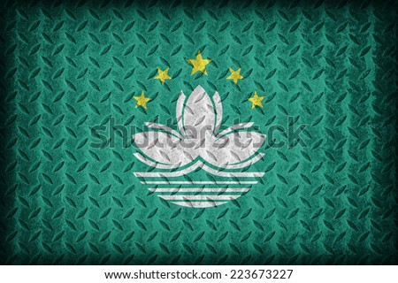 Macau flag pattern on the diamond metal plate texture ,vintage style - stock photo