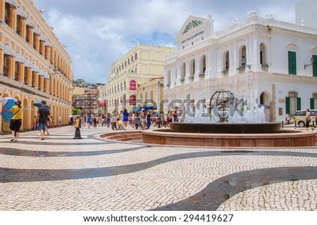 MACAU - JULY 1, 2013: Historic Centre of Macau-Senado Square in Macau, China. The Historic Centre of Macau was inscribed on the UNESCO World Heritage List in 2005. - stock photo