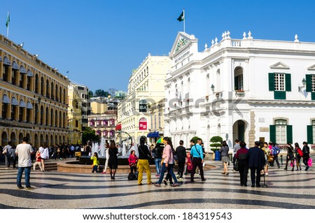MACAU-MARCH 26 : Tourists visit the Historic Centre of Macao on March 26, 2014 in Macau, China. The Historic Centre of Macao was inscribed on the UNESCO World Heritage List in 2005. - stock photo