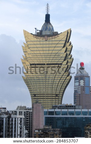 Macau - May 25, 2008: The Grand Lisboa Casino in Macau. Opened in 2008, the casino offers 800 mass gaming tables and 1000 slot machines. - stock photo