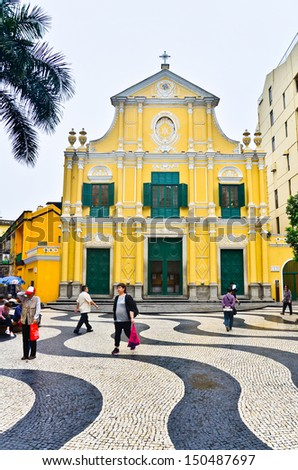 MACAU-MAY 9 : Tourists visit the Historic Centre of Macao-Senado Square on May 9, 2013 in Macau, China. The Historic Centre of Macao was inscribed on the UNESCO World Heritage List in 2005. - stock photo