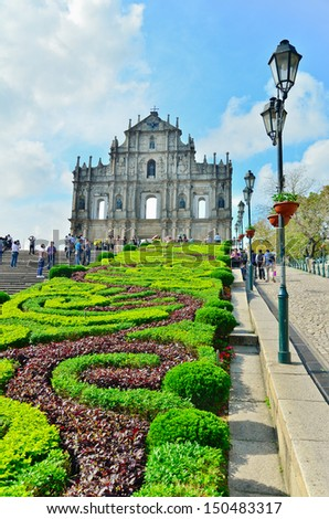 MACAU-MAY 9 : Tourists visit the Historic Centre of ruined church of St Paul on May 9, 2013 in Macau, China. The ruined church of St Paul was inscribed on the UNESCO World Heritage List in 2005. - stock photo