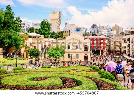 MACAU-NOVEMBER 16: Tourists visit the Historic Centre of ruined church of St Paul on November 16, 2015 in Macau, China. The ruined church of St Paul was inscribed on the UNESCO World Heritage in 2005. - stock photo