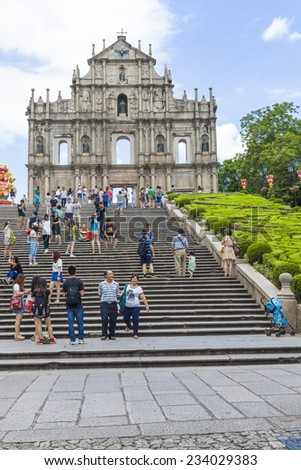MACAU: SEP 1 : Tourists visit the ruined church of St Paul on 1 September 2014 in Macau, China. The ruined church of St Paul was inscribed on the UNESCO World Heritage List in 2005. - stock photo