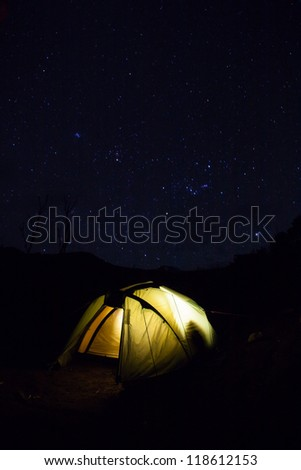Machame Camp is the first campsite on the Machame Route. An impressive night sky over a tent on a clear night. - stock photo