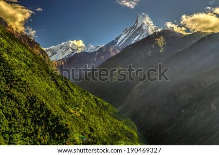 Machapuchare mountain and Modi Khola valley in Himalayas, Nepal - stock photo