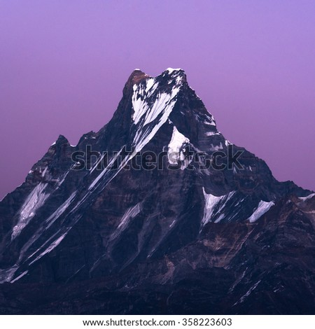 Machapuchare or Fishtail peak with moonlight at night. it is a mountain in the Annapurna Himal of north central Nepal. - stock photo