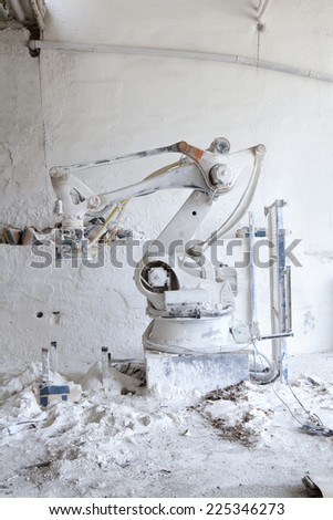 Machine covered on gypsum in a cement factory. Dirty machine. - stock photo