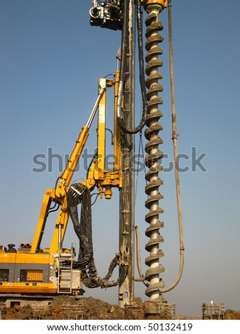 machine for drilling holes in the ground - stock photo